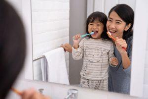 happily brushing their teeth
