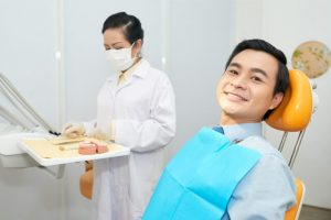 The dentist prepares the materials before making a dental impression.