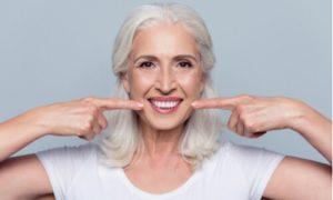 oral status implant cost